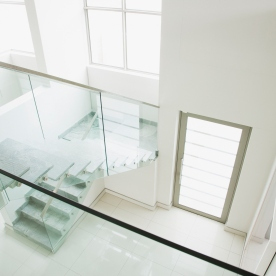 Glass railing on staircase in modern house