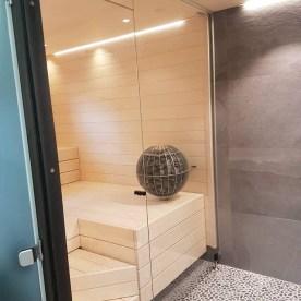 saunan lasiseinä ja kylpyhuone JVG Laseja Oy